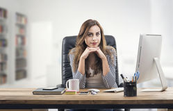 Young businesswoman in office. Beautiful Young Businesswoman Royalty Free Stock Images