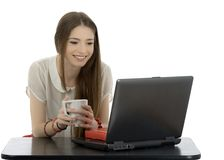 Young businesswoman at an office desk with a cup of coffe isolat Stock Photos