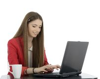 Young businesswoman at an office desk with a cup of coffe isolat Royalty Free Stock Image