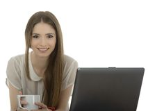 Young businesswoman at an office desk with a cup of coffe isolat Stock Photography