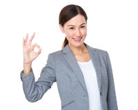 Young businesswoman with ok sign gesture Royalty Free Stock Image
