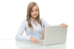 Young businesswoman opening laptop cover Stock Images