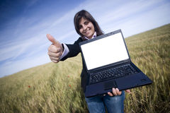 Young businesswoman outdoor with laptop. Focus on the hand and laptop Stock Images