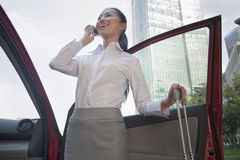 Young Businesswoman outside of her car talking on the phone Stock Images