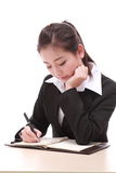 Young businesswoman with pen Stock Images