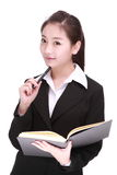 Young businesswoman with pen Stock Image