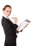Young businesswoman with pen and clipboard Stock Images