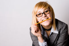 Young businesswoman with pencil Royalty Free Stock Image