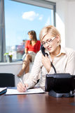 Young businesswoman on phone Royalty Free Stock Photo