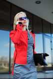 Happy young fashion business woman calling on cell phone Royalty Free Stock Images