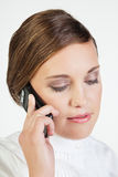 Young businesswoman with phone. Head portrait of young smiling businesswoman talking on cellphone Royalty Free Stock Photo