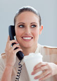 Young businesswoman on phone drinking a coffee Stock Photography