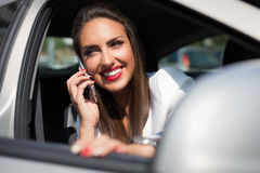 Young businesswoman on the phone in her car Royalty Free Stock Photo