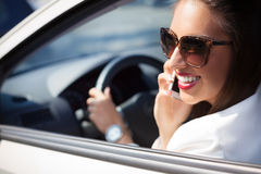Young businesswoman on the phone in her car Royalty Free Stock Images