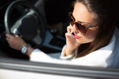 Young businesswoman on the phone in her car Stock Images