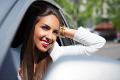 Young businesswoman on the phone in her car Stock Photo