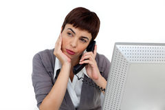 Young Businesswoman on phone at her desk Royalty Free Stock Photography