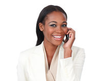 Young businesswoman on phone smiling at the camera Stock Photography