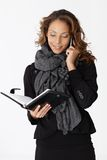 Young businesswoman on phone smiling Royalty Free Stock Photos
