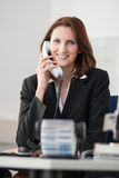 Young businesswoman phones Stock Photos