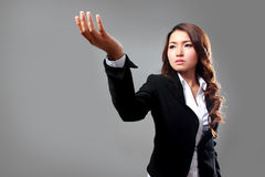 Young businesswoman picking an item Royalty Free Stock Photo