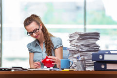 The young businesswoman with piggy bank in the office Royalty Free Stock Images