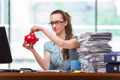 The young businesswoman with piggy bank in the office Royalty Free Stock Photography
