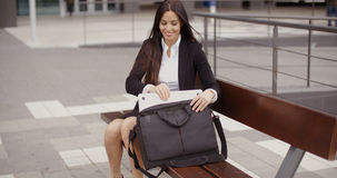 Young Businesswoman Placing Her Laptop In A Bag Stock Photography