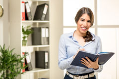 Young Businesswoman With Planner Royalty Free Stock Images
