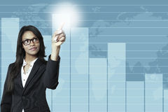 Young businesswoman pointing in a business graph Stock Images