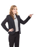 Young businesswoman pointing on copyspace, isolated on white bac Stock Photography
