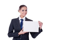 Young businesswoman pointing into empty Stock Photos
