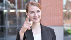 Young Businesswoman Pointing with Finger Outdoor. 4k high quality, 4k high quality stock video footage
