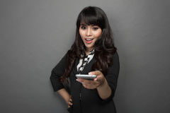 Young businesswoman pointing with a handphone Royalty Free Stock Photography