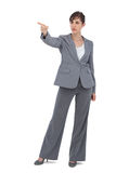 Young businesswoman pointing to something Stock Images