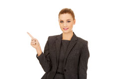 Young businesswoman pointing up. Stock Photography