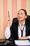 Young businesswoman pointing up with pencil Stock Photography