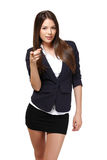 Young businesswoman pointing at you Stock Photos