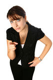 Young businesswoman points at viewer Stock Image