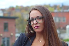 Young businesswoman portrait glasses outside in the city Royalty Free Stock Images
