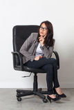 Young businesswoman posing in office chair for her startup job Stock Images