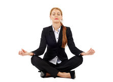 Young businesswoman practicing yoga Stock Image