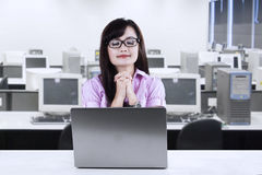 Young businesswoman praying at office Royalty Free Stock Images