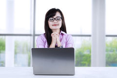 Young businesswoman praying at office 1 Royalty Free Stock Images
