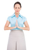 Young businesswoman praying Royalty Free Stock Photos