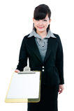 Young Businesswoman Presenting Clipboard Royalty Free Stock Image