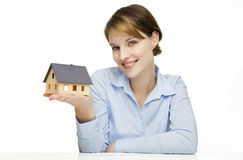 Young businesswoman presenting a model house. Young friendly smiling businesswoman presenting a model house Stock Photos