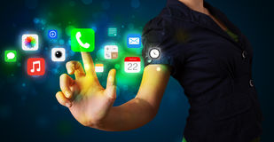 Young businesswoman pressing colorful mobile app icons with boke Royalty Free Stock Photography