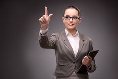 The young businesswoman pressing virtual button Royalty Free Stock Images