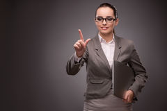 The young businesswoman pressing virtual button Stock Photography